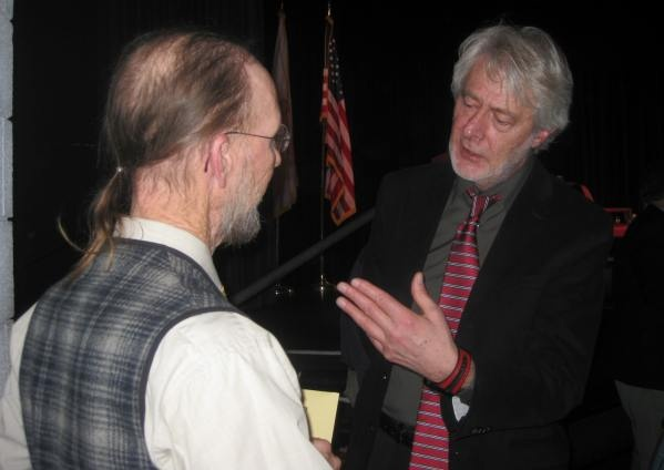 Professor Padraig O'Malley, right, speaks with Dr. Brian O'Malley, no relation, of Provincetown followed his presentation Wednesday afternoon at Cape Cod Community College. More than 400 attended.