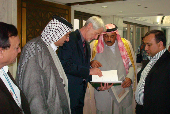 Padraig O'Malley (center), a professor of peace and reconciliation at the University of Massachusetts-Boston, in Baghdad in July 2008, after the signing of the Helsinki II agreement between representatives of all political parties in Iraq. O'Malley, who has been a key figure in helping settle sectarian conflict in Northern Ireland, will speak at a two-day justice conference hosted by BU's Institute for Philosophy and Religion. Photo by Nancy Riordan